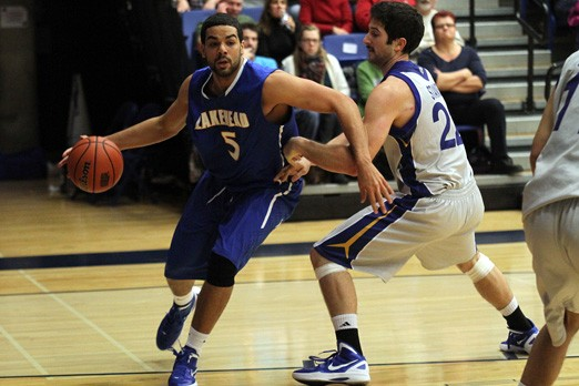 Yoosrie Salhia (left) works it underneath for Lakehead, battling Ryerson