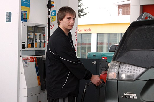 Curtis Bagnall fills up his tank on Feb. 29, 2012.