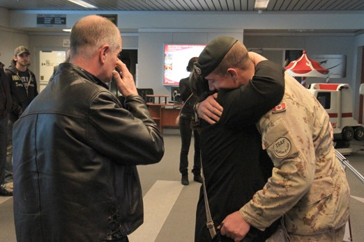 Cale McDowell (right) hugs his mother Darlene after arriving home to Thunder Bay Wednesday.