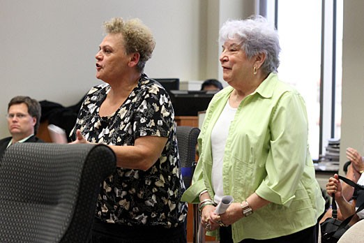 Audrey Mackenzie (left) and Elanor St.Lawrence attend a city council meeting on June 11, 2012.