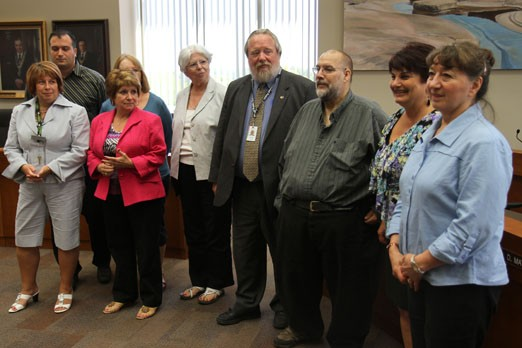 The city's disaster relief committee poses for a photo Friday afternoon.