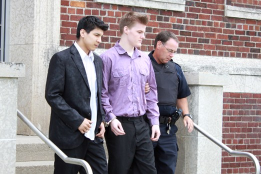FILE -- Sheldon Wabason on left, Nicholas Webber in centre leave the Superior Court of Justice in this July 2012 file photo.