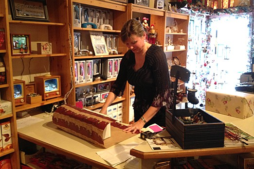 Marlene Koskiniemi wraps a present on Dec. 20, 2012.