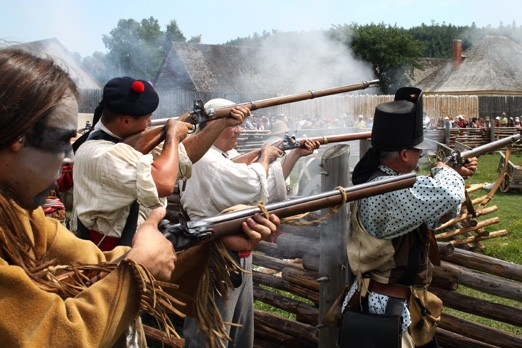 A mock battle takes place at Fort William Historical Park to celebrate the bi-centennial of the War of 1812.