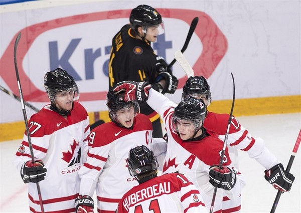 Canada captain Ryan Nugent-Hopkins, centre, celebrates his goal with teammates while playing against Germany during first period IIHF World Junior Championships hockey action in Ufa, Russia on Wednesday, Dec. 26, 2012.