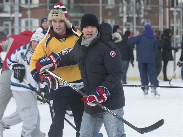 Montreal Canadiens defenceman Josh Gorges, right, watches the play during a game of pick-up hockey in Montreal, Wednesday, December 26, 2012. Gorges used Twitter to organize a Boxing Day outdoor hockey game with fans at a neighbourhood rink in Montreal.