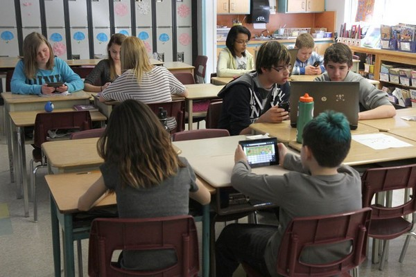File -- Students use tablets, laptops and other electronic devices at Kingsway Park Public School in this file photo from February 2013.