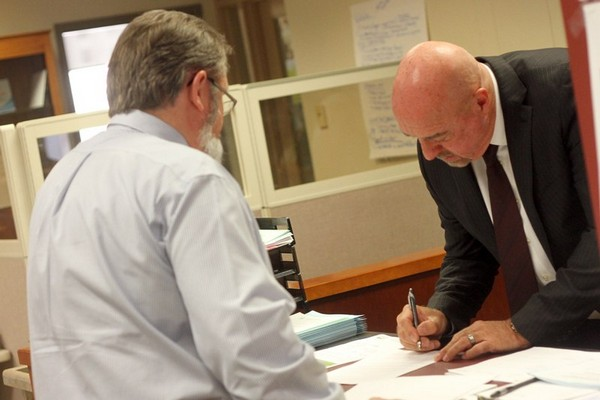 Mayor Keith Hobbs (right) files for re-election Monday in the city clerk