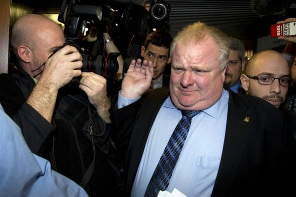 oronto Mayor Rob Ford grabs a photographer