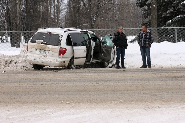 A van rests in a snowbank after a collision on Balmoral Street Friday morning.