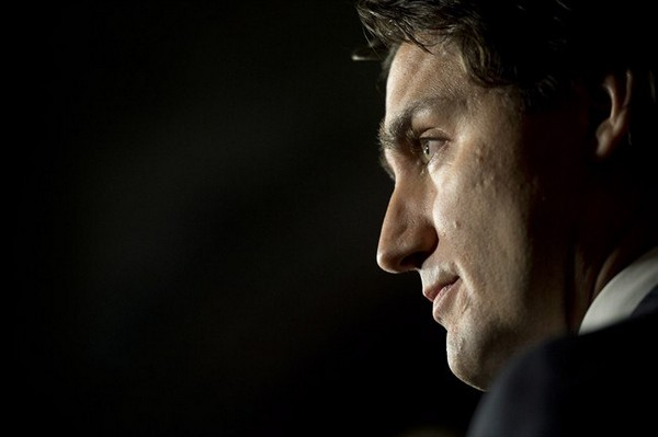 Liberal leader Justin Trudeau speaks about the Senate and Liberal senators during an announcement in the Foyer of the House of Commons Wednesday January 29, 2014 on Parliament Hill in Ottawa. THE CANADIAN PRESS/Adrian Wyld