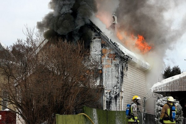 Firefighters battle a blaze on Fitzgerald Street Monday afternoon.