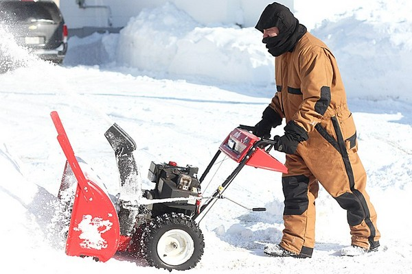 Chris Grant finishes snowblowing his Empire Street driveway on Friday morning.