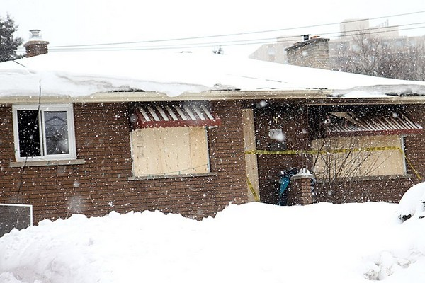 The front doors and windows of a Walkover Street house were boarded up after a fire early Monday morning.