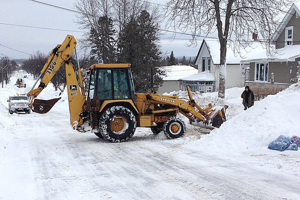 City residents are breaking out heavy equipment to aid in snow removal after Friday