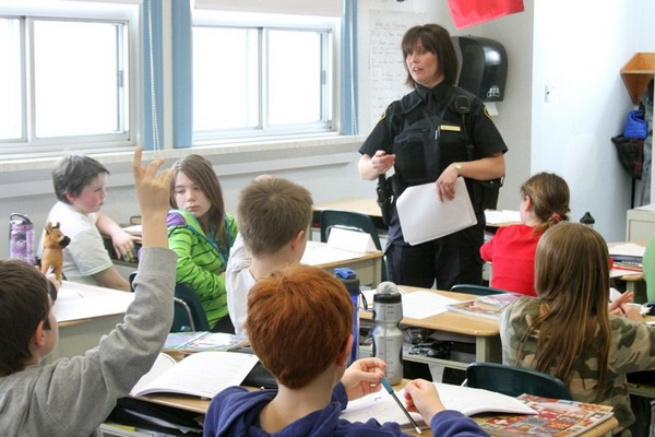 OPP Const. Diana Cole speaks to students at McKenzie Public School Monday afternoon.