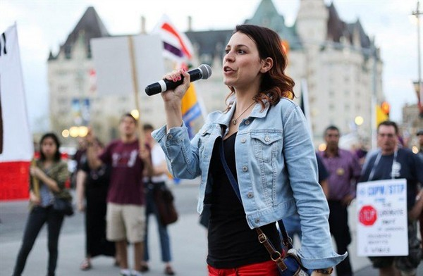 Anne-Marie Roy, president of the Student Federation of the University of Ottawa, speaks at a May Day rally in Ottawa on May 1, 2013. She is speaking out about an online conversation among five fellow students in which she was the target of sexually graphic banter. THE CANADIAN PRESS/HO-Bew Powless