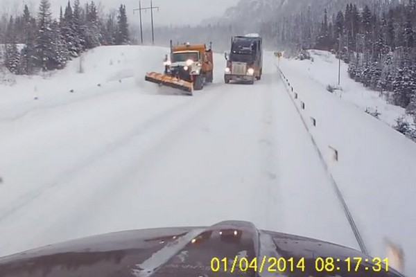 This screen capture of a dashboard camera video that showed two trucks nearly involved in a head-on crash on Highway 11 in January. The driver posted the video on YouTube, where it went viral.