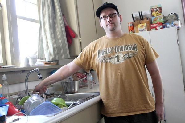 Sprague Street resident Mike Donio and his family are frustrated they've been without water for more than a week as city crews try to catch up thawing frozen residential water pipes.