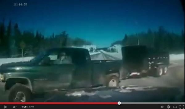 FILE -- A screen capture moments before a highway crash in Northern Ontario shows what appears to be the driver of a pickup truck on a cellphone. Dramatic video of the crash was shared on social media Tuesday.