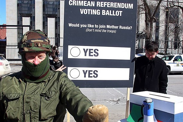 A protestor disguised in military colours a takes part in a mock referendum to draw attention to the Crimean referendum Sunday March 16, 2014 outside the Russian Embassy in Ottawa, Sunday March 16, 2014.