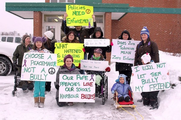 Parents and students rally Monday night outside Thunder Bay Catholic District School Board headquarters, protesting what they say is a lack of response to rampant bullying in the board