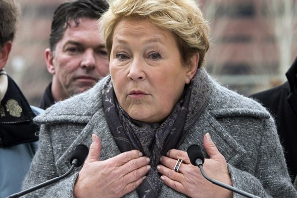 Parti Quebecois leader Pauline Marois speaks to the media as while campaigning Saturday, March 29, 2014 in Montreal, Que.. Quebecers will vote in a provincial election April 7, 2014.