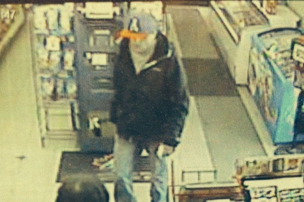 Police are hoping someone can identify this suspect wanted in a pair of Thursday armed robberies.