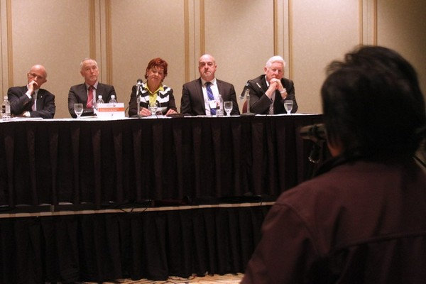 A panel, including Alan Coutts second from right, listens to a question Thursday evening.