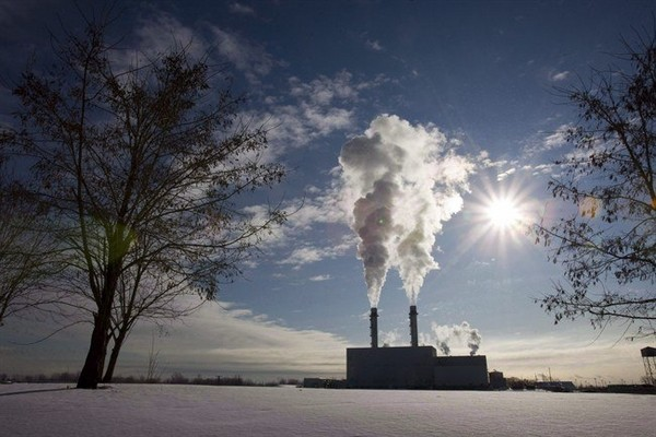 Smoke pours from the stacks at the Portlands Energy Centre in Toronto, January 15, 2009. An environmental analyst says a new report revealing that oil and gas production has become the single biggest source of greenhouse gas emissions adds further weight to calls for Ottawa to regulate the sector.