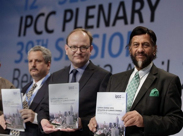 Ramon Pichs Madruga, Co-Chairman of the IPCC Working Group III, Ottmar Edenhofer, Co-Chairman of the IPCC Working Group III, and Rejendra K. Pachauri, Chairman of the IPCC, from left, pose prior to a press conference as part of a meeting of the Intergovernmental Panel on Climate Change (IPCC) in Berlin, Germany, Sunday, April 13, 2014. The panel met from April 7, 2014 until April 12, 2014 in the German capital.