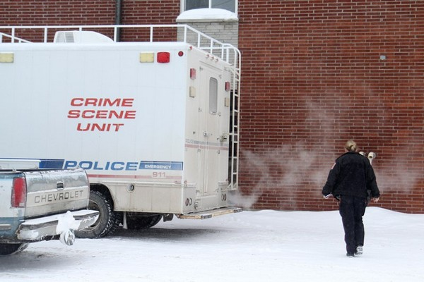 FILE -- police investigate the scene of a homicide January, 2014.
