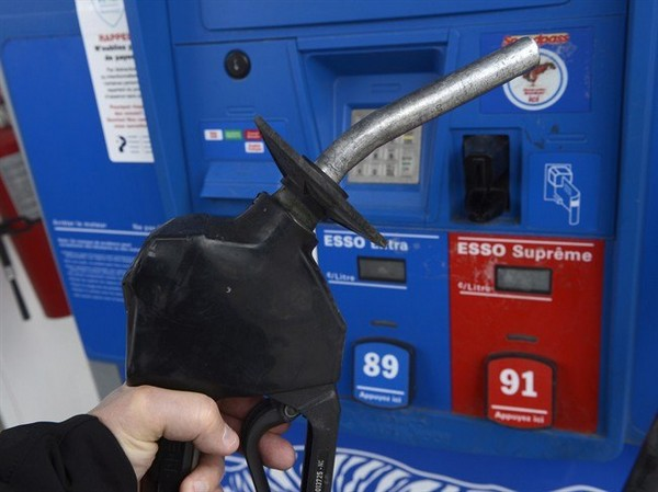 A fuel nozzle is shown at a Montreal gas station on Wednesday, April 23, 2014. It