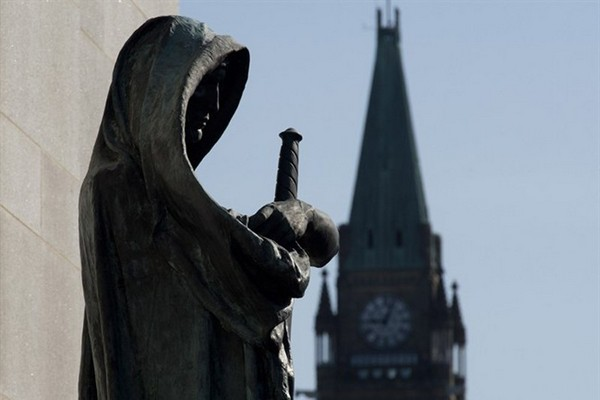 Veritas (Truth) guards the entrance of the Supreme Court of Canada as the Peace tower is seen in the background on Friday April 25, 2014 in Ottawa. The court has shot down Harper