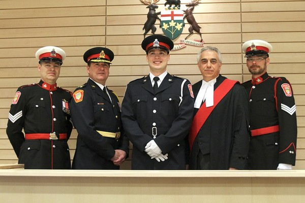 From left: Sgt. Ron Maki, Police Chief J.P. Levesque, Const. Mike Biloski, Justice Dino Di Guiseppe and Sgt. Mike Sweitzer at Biloski's swearing-in ceremony at the Thunder Bay Courthouse.