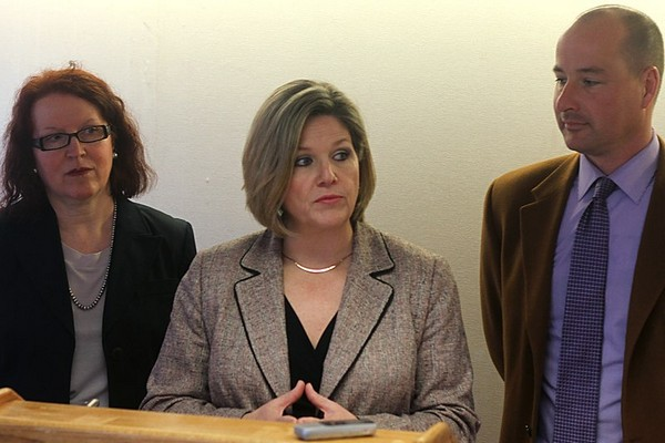 Ontario NDP leader Andrea Horwath announces a plan to enhance safety on northern roads while being flanked by Thunder Bay-Atikokan NDP nominee Mary Kozorys (left) and Thunder Bay-Superior North NDP candidate Andrew Foulds (right) at the Valhalla Inn on Saturday.