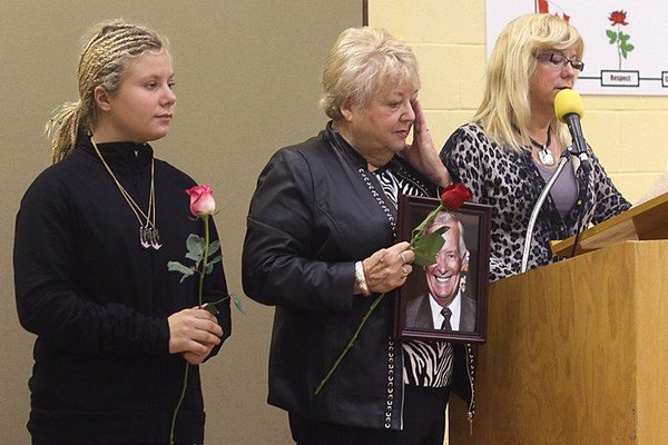 The family of the late Robert Nelson speaks during the National Day of Mourning for injured and fallen workers at the Lakehead Labour Centre on Monday.