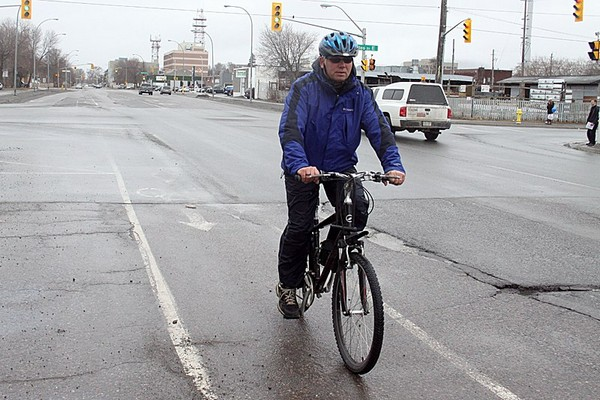 Local cyclist Ken Shields bikes in the designated bike lane on Vickers Street Thursday afternoon.