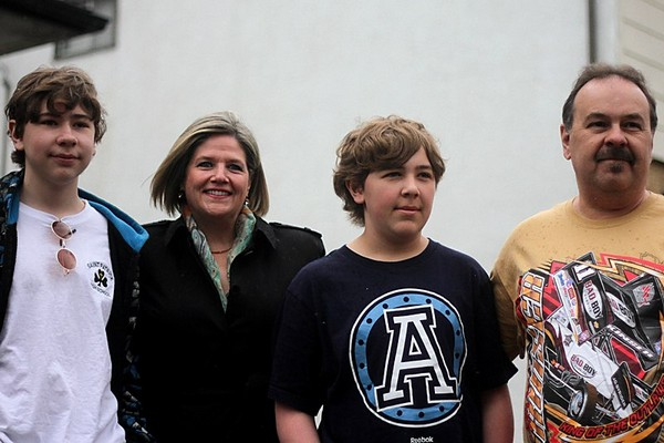 Aaron, Cale and Jeff Caldwell pose with Ontario NDP Leader Andrea Horwath (second from left) outside their home on Monday.