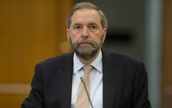 Official Opposition Leader Tom Mulcair waits to appear at Commons house affairs committee to explain the use of House of Commons resources by the Official Opposition Thursday May 15, 2014