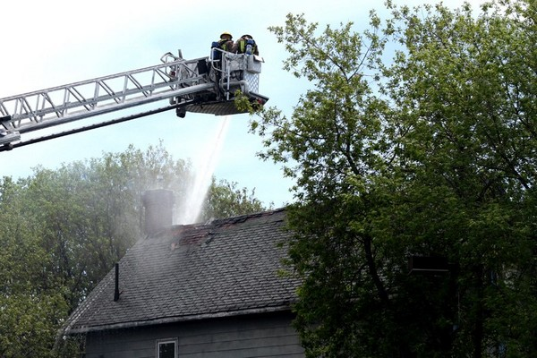 Fire crews work to put out a blaze on May Street Wednesday afternoon.