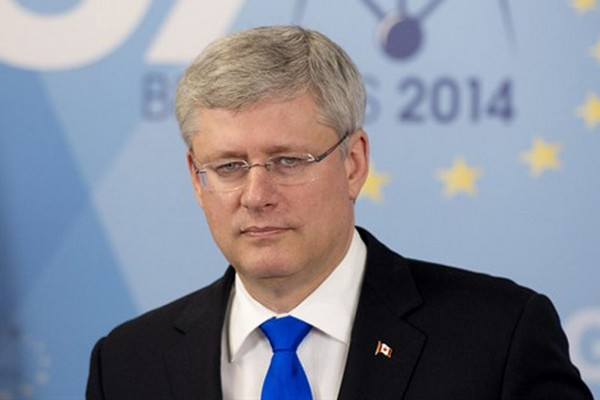 Canadian Prime Minister Stephen Harper speaks with the media during a news conference following the G7 meetings Thursday June 5, 2014 in Brussels, Belgium.