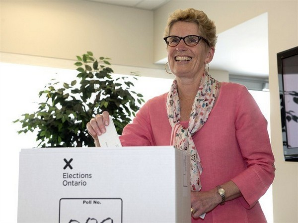 Ontario Liberal leader Kathleen Wynne casts her ballot in Toronto on Thursday June 12, 2014