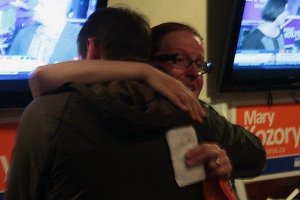 Mary Kozorys embraces a supporter at her results viewing party at Chicago Joe