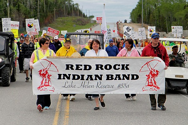 Protesters march across the Nipigon River Bridge on Friday to demonstrate their opposition to storing nuclear waste in Northwestern Ontario.