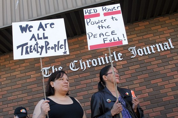 Protesters gathered Thursday outside the Chronicle Journal's Cumberland Street offices, still upset at the paper's decision to run a controversial, racially charged political ad on June 10.