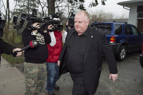 Toronto Mayor Rob Ford leave his home in Toronto, early Thursday, May 1, 2014. Ford is set to leave rehab Monday, returning to the intense public glare from which he has been relatively absent for two months since he was forced to seek help amid fresh allegations of drinking and drug use.