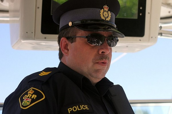 OPP acting Sgt. David Moscell talks boating safety on board a police boat.