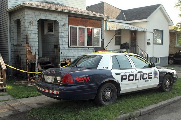 Police are guarding a Cumming Street home after an early-morning fire.
