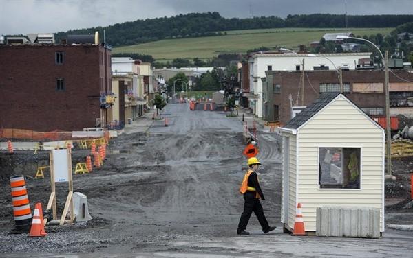 The main street of Lac-Megantic remains closed Friday, July 4, 2014. Residents prepare for the first year anniversary when an oil-filled train screeched off the tracks and exploded killing 47 people and destroying part of the downtown core.